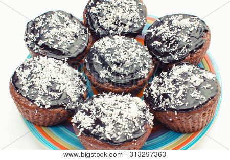 Fresh Baked Muffin With Cocoa, Chocolate And Desiccated Coconut On Colorful Plate. White Background.
