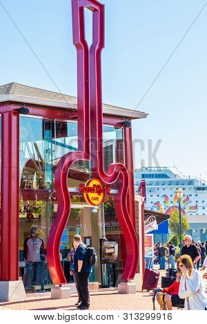 San Francisco, California - October 05 2017: Tourists And Other People By The Giant Red Guitar Logo