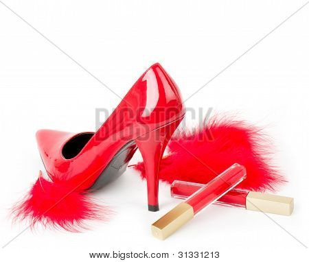 Sexy fashionable shoe and red lipstick on white background.