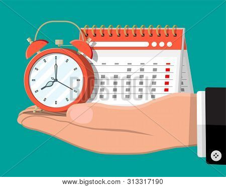 Paper Spiral Wall Calendar And Clocks In Hand. Calendar And Alarm Clocks. Schedule, Appointment, Org