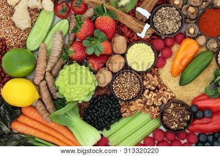 Liver detox diet health food concept with fresh fruit, vegetables, herbs, spices, legumes, herbal medicine, nuts, grains &  seeds. Foods high in antioxidants, anthocaynins, vitamins & dietary fibre.