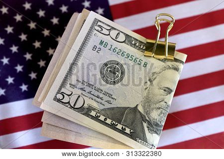 American Fifty Dollar Notes On The American Flag.