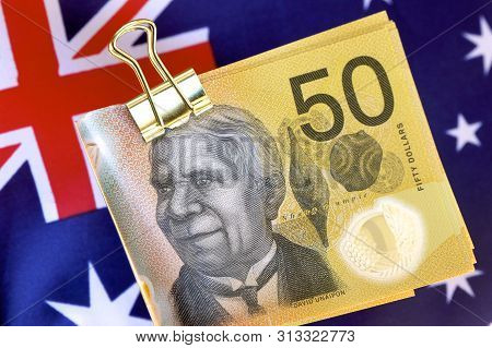 A Clip With Australian Fifty Dollar Notes And The Australian Flag.