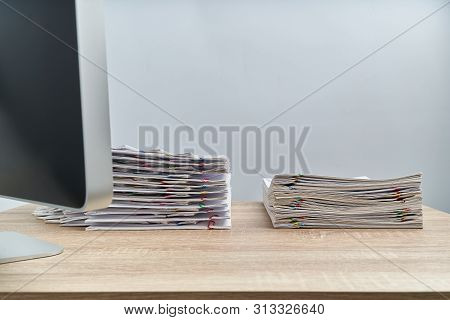 Arrange Pile Overload Document Report And Computer On Wooden Table
