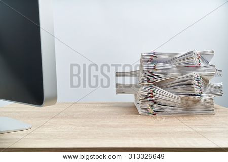 Arrange Of Paperwork Overload Report And Computer On Wooden Table