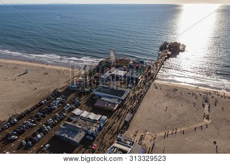 Santa Monica, California, USA - December 17, 2016:  Afternoon aerial of Santa Monica Pier and the Pacific Ocean in Los Angeles County on the scenic Southern California coast.