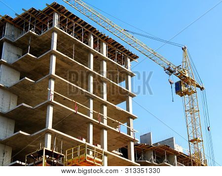 Tower Crane And Building Activity. Construction Site Background.