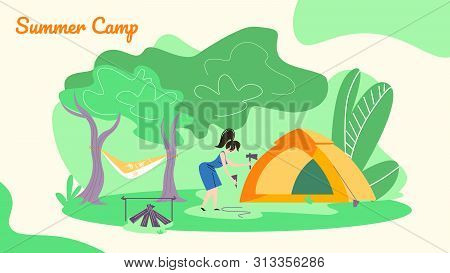 Young Woman Hummer Sticks To Ground To Set Up Tent For Spending Time At Summer Camp In Forest. Hammo