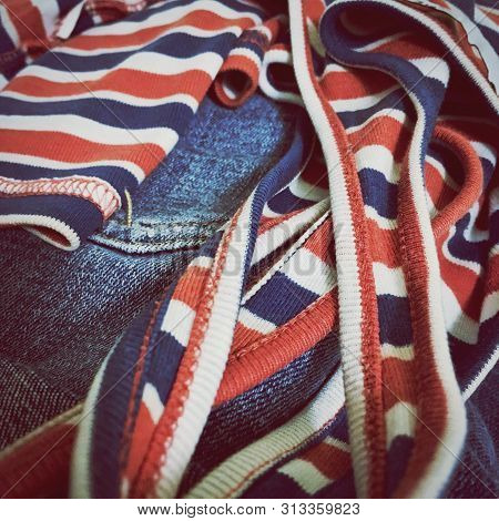 Red, White And Blue Cotton Shirt On Pair Of Blue Jeans