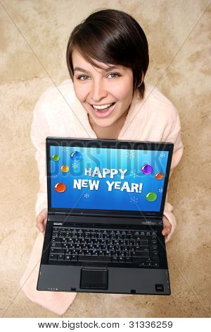Happy Woman Sitting On The Carpet With Laptop