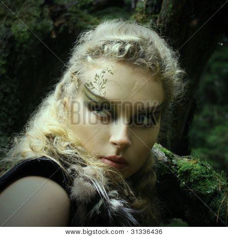 Elf girl in a summer wood