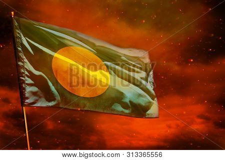 Fluttering Palau flag on crimson red sky with smoke pillars background. Palau problems concept. poster