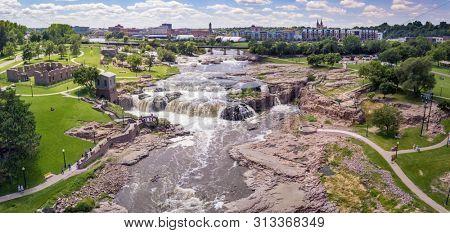 Aerial panorama of the falls in Sioux Falls, South Dakota and Falls Park.