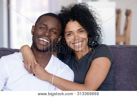 Headshot Portrait Of Happy African Millennial Couple Looking At Camera