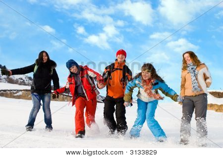 Group Of Sport Teens Different Ethnicity Jumping Winter Outdors At Mountain Tien Shan. One Boy And F