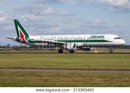 Amsterdam / Netherlands - August 14, 2014: Alitalia Airbus A321 I-bixa Passenger Plane Landing At Am