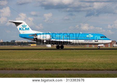 Amsterdam / Netherlands - August 14, 2014: Klm Fokker 70 Ph-wxc Passenger Plane Landing At Amsterdam