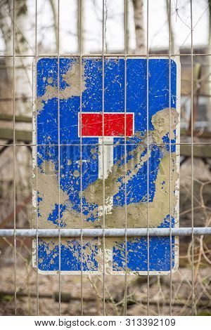 Dirty German Dead End Traffic Sign,behind A Metal Fence
