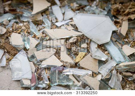 Flinders Of A Broken Mirror On The Ground