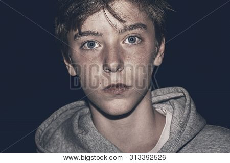Portrait Of A Young Serious Man In The Night