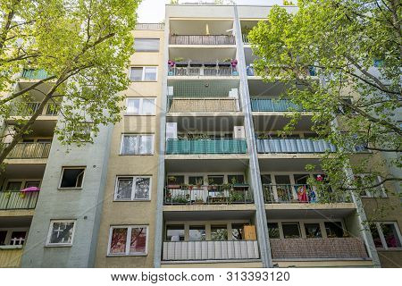Poor Berlin House With Balconies And Trees