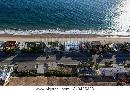 Aerial view of beach houses near Los Angeles on Pacific Coast Highway in Malibu, California.