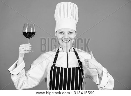 A Glass Of Red Wine Is Okay. Happy Wine Expert Showing Thumbs Up Gesture With Wine Glass In Hand. Pr