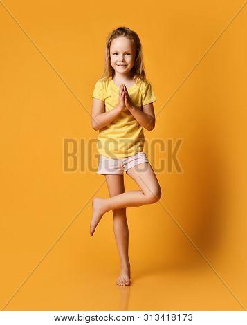 Smiling Girls Practicing Yoga, Standing In Vrikshasana Tree Pose, Working Out Wearing Sportswear, T-