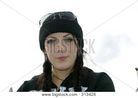 Young Woman In Cap