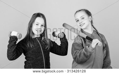 Ways To Help Kids Find Sport They Enjoy. Girls Cute Kids With Sport Equipment Dumbbells And Baseball