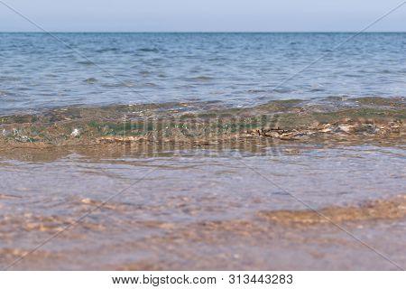 Soft Ocean Wave On Sandy Beach Stock Photo