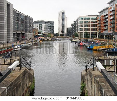 Leeds, West Yorkshire, United Kingdom - 4 July 2019: A View Of Leeds Dock From The Lock Gates With H