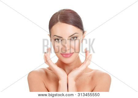 Beauty Face Of The Young Beautiful Woman Posing. Close Up Portrait Smiling Lady Looking At You Camer