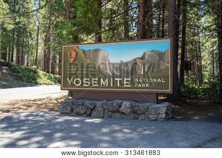 Yosemite, California - July 11, 2019: Sign For Yosemite National Park Welcomes Park Visitors To The