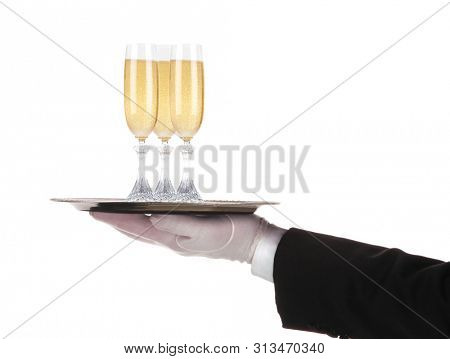 Waiter with three glasses of champagne in his outstretched hand on a silver serving tray, isolated on white.