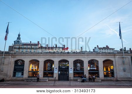 Lyon, France - July 17, 2019: Only Lyon Sign On The Tourism Office Of Bellecour Square At Night. It