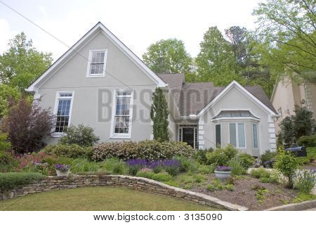 Grey Stucco With Flower Garden