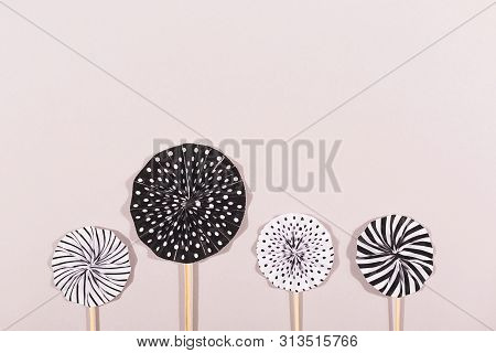 Party accessories on grey background. Cake toppers. Holiday, celebration, Birthday or Black Friday concept. Flat lay, top view. Copy space. poster
