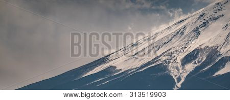 Close Up Top Of Fuji Mountain With Snow Cover On The Top With Could,  Fuji-san.