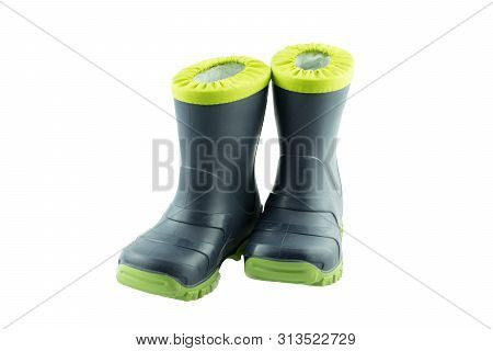 Children Shoes And Boots. Closeup Of A Pair Blue Rubber Boots Isolated On A White Background. Kids S