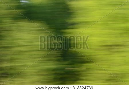 Fast Moving Passenger Train Through Siberian Forest Abstraction