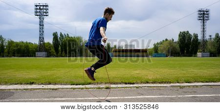 Male Athlete Sportsman Practice With Jump Rope At The Outdoor Stadiums, Increase Stamina