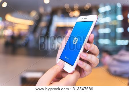 Chiang Mai, Thailand - May.10,2019: Woman Holding Apple Iphone 6s Rose Gold With Skype Apps At Shopp