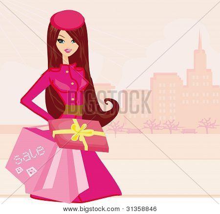 chica de compras de moda con bolsas y caja de regalo