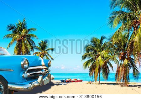 The Tropical Beach Of Varadero In Cuba With American Classic Car, Sailboats And Palm Trees On A Summ