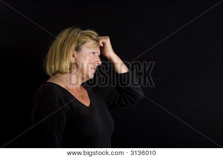 Senior Lady Hand On Head