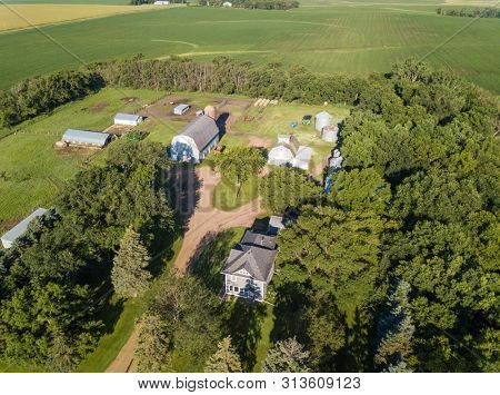 Aerial view of quaint farmhouse and barns on a farm in South Dakota.