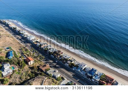 Aerial view of beaches and homes along Pacific Coast Highway north of Santa Monica and Los Angeles in scenic Malibu California.