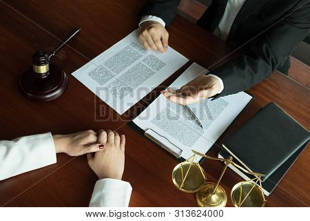 Lawyer Working With Contract Client On The Table In Office. Consultant Lawyer, Attorney, Court Judge