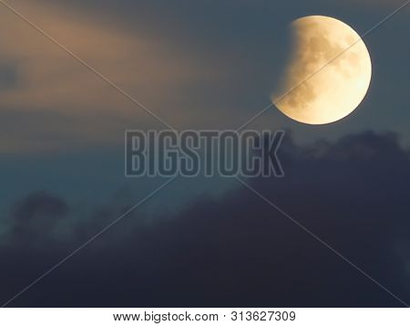 Lunar Eclipse Whit Clouds In Blue Hour